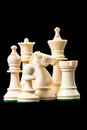 White chess pieces on black Stock Image