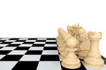 A white chess set with chessboard on background Royalty Free Stock Image