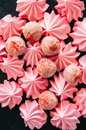 White chocolate and strawberry truffles and pink meringue kisses Royalty Free Stock Photo