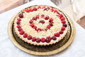 White chocolate tart with cherries and elder tree flowers Royalty Free Stock Photo