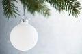 White christmas ball on the xmas tree on glitter bokeh background. Merry christmas card. Royalty Free Stock Photo