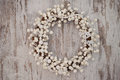White christmas decorative wreath over wooden background Royalty Free Stock Photo