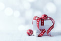White christmas gift with red ribbon and balls Stock Photos
