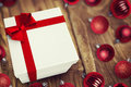A white Christmas gift with ribbon Royalty Free Stock Photo