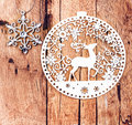 White christmas ornaments on rustic wooden board retro christma star and lacy deer over wood background vintage style Stock Photo