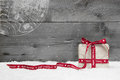 White christmas present with long ribbon snow on grey international greeting card wood and a red gift box Royalty Free Stock Photography