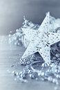 White christmas star arrangement of and silver decorations close up Royalty Free Stock Images