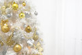 White christmas tree with gold decoration on white background Royalty Free Stock Photo