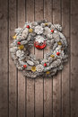 White Christmas wreath on wooden door Royalty Free Stock Photo