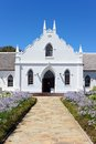 White Church in Franschhoek in front of blue sky Stock Photos