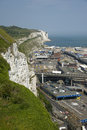 White cliffs of dover and commercial harbour kent england july vehicle passenger ferries at international port kent Stock Image