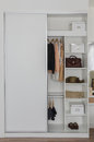White closet with clothes and accessories Royalty Free Stock Photo