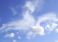White clouds and blue sky background in Stock Image