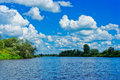 White clouds over bank river vyatka Royalty Free Stock Photos