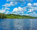 White clouds over the steep bank of the river vyatka Royalty Free Stock Photography