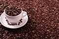 White coffee cup filled with roasted beans copy space Royalty Free Stock Photo
