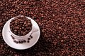 White coffee cup filled with roasted beans copy space background Royalty Free Stock Photo