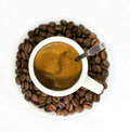 White coffee cup with grains of coffee and an appetizing skin isolate it is isolated on the white Stock Photography