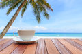 White coffee cup on wood table and view of nature background Royalty Free Stock Photo