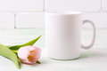 White coffee mug mockup with  pink tulip Royalty Free Stock Photo