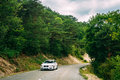 White colour BMW car on background of French mountain nature landscape Royalty Free Stock Photo