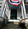 Bunting covered entryways welcome many new US citizens to 4th of July celebrations Royalty Free Stock Photo