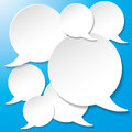 White communication speech bubbles blue background on the eps file Stock Photography
