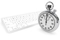 White computer keyboard with stopwatch Royalty Free Stock Image