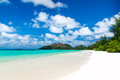 White coral beach sand and azure indian ocean mahe island seychelles the island of dreams for a rest relaxation a heavenly place Stock Photography