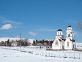 White country church in a winter day Royalty Free Stock Photo