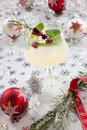 White cranberry spritzer close up of cocktail on holiday table with christmas ornaments holiday cocktails series Royalty Free Stock Image