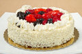 White Cream Icing Cake with Fruits Stock Images