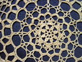 White crochet on blue background Stock Images