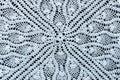 White crochet fabric on black background