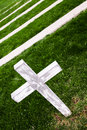 White cross in a old cemetery lonely Stock Photography