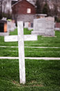 White cross in a old cemetery lonely Royalty Free Stock Photos