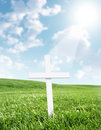 White cross shined upon from heaven Stock Image