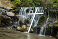 White cross waterfall water falling down over a Stock Photos