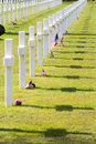 White crosses of the world war ii normandy american cemetery and memorial two in france based in a small city village colleville Stock Image