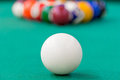 White cue ball on green cloth close up Royalty Free Stock Images