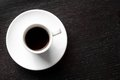 White cup with black coffee with space for text top of view of a over wood table Stock Photo