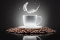 White cup with coffee beans and milk splash on black Stock Photo