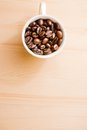 White cup of coffee beans with space for text Royalty Free Stock Photo