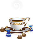White cup with coffee and chocolates.Illustrations Stock Photo