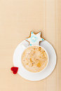 White cup coffee christmas gingerbread cake star heart symbol love of hot beverage drink cappuccino latte with homemade with icing Royalty Free Stock Photography
