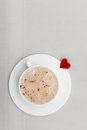 White cup coffee hot drink and heart symbol love valentine s day of beverage cappuccino latte with shape Royalty Free Stock Images