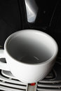 White cup on at coffee machine empty Stock Photography