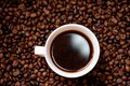 White cup of hot fresh and aromatic coffee detail view from top Royalty Free Stock Images