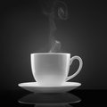 White cup with hot liquid and steam on black Royalty Free Stock Image