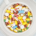 White cup on the plate filled with pills Stock Images